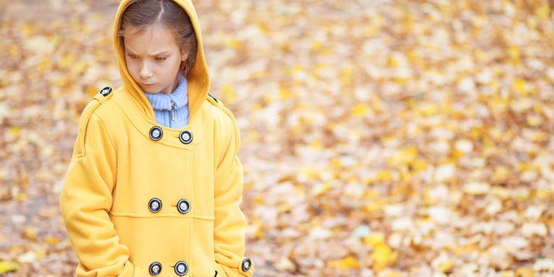 sad beautiful girl in yellow jacket